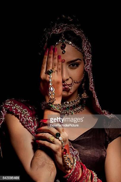 Portrait of Indian bride hiding half her face