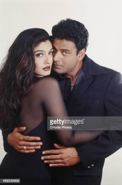 2002 Portrait of Indian film actor Manoj Bajpai and actress Raveena Tandon