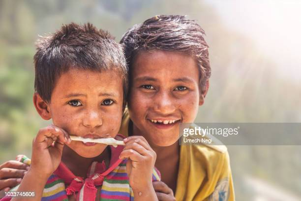 portrait of indian little boy with ice cream - human body part stock pictures, royalty-free photos & images