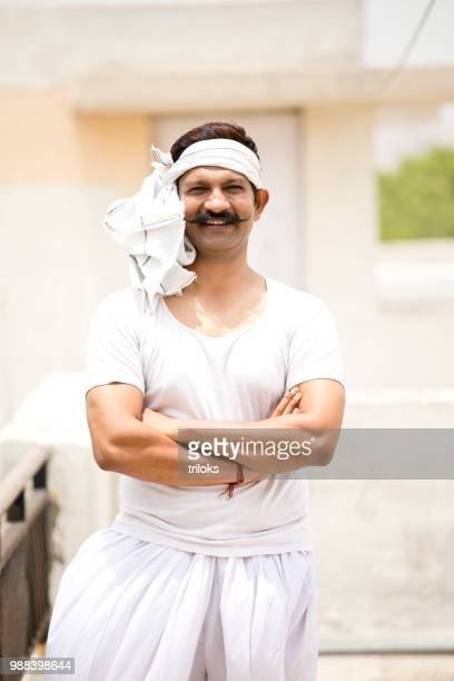 portrait of indian man - milkman stock photos and pictures
