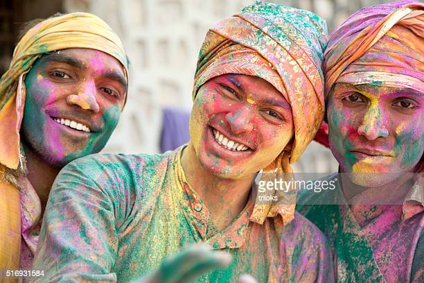 portrait of indian men playing holi - editorial stock pictures, royalty-free photos & images