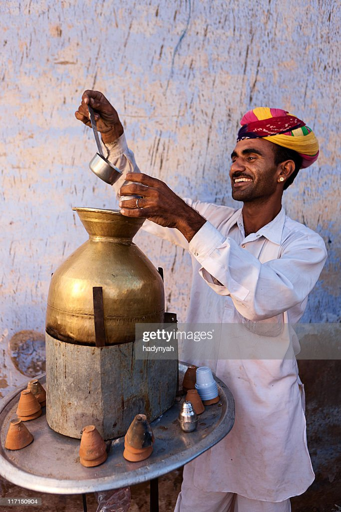 Portrait of Indian street seller selling tea - masala chai : Stock Photo