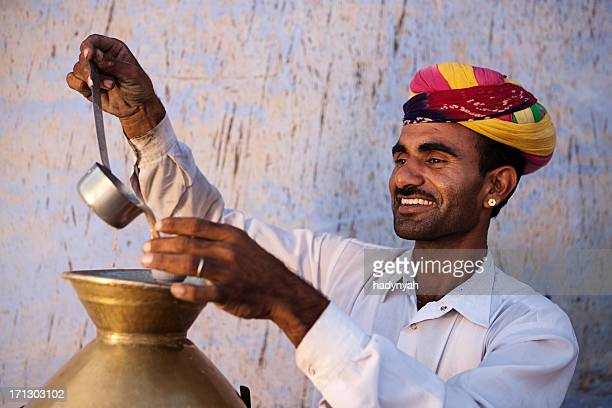 Portrait of Indian street seller selling tea - masala chai