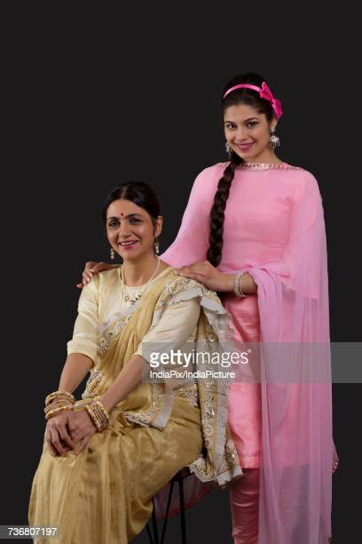 portrait of indian two generation females dressed in retro style - salwar kameez stock photos and pictures