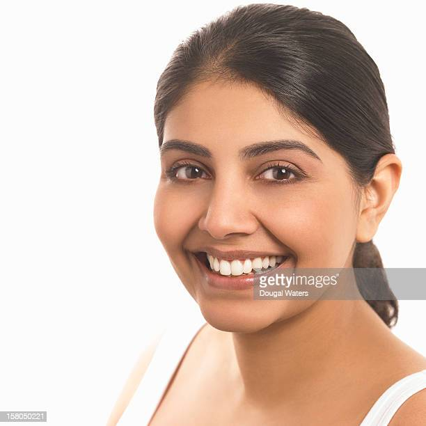 Portrait of Indian woman on white background.