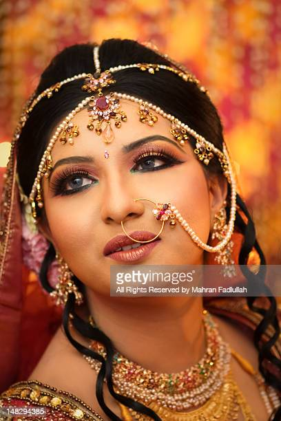 portrait of indian/bangladeshi bride - bangladeshi bride stock photos and pictures