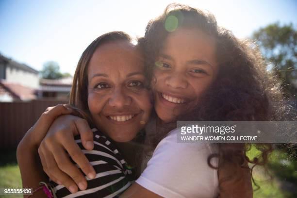 Portrait of Indigenous aboriginal Australian mother and daughter in Australian suburban backyard