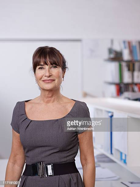 portrait of individual architect - 60 years old woman stock photos and pictures