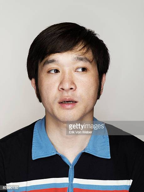 portrait of individual on a white background - east asian ethnicity stock pictures, royalty-free photos & images