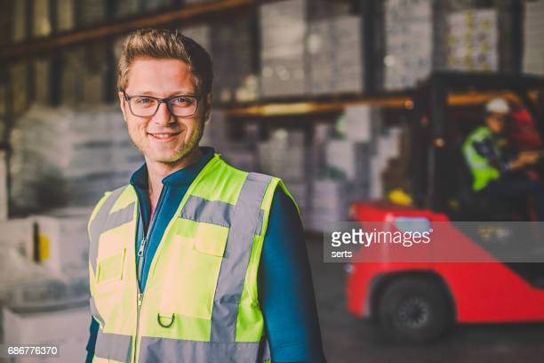 Portrait of industry manual worker in warehouse
