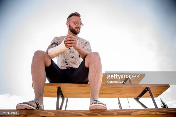 portrait of injured athlete - broken arm stock pictures, royalty-free photos & images