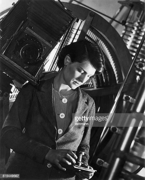 Portrait of internationally famous industrial photographer Margaret BourkeWhite holding a camera
