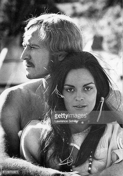 Portrait of Irish actor Richard Harris and Greek actress Corinna Tsopei on the set of the film 'A Man Called Horse' Mexico 1968