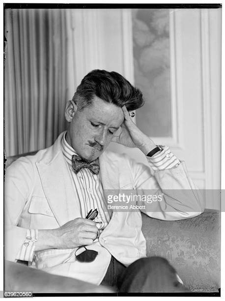 Portrait of Irish author James Joyce as he sits in an armchair his hand on his head 1926