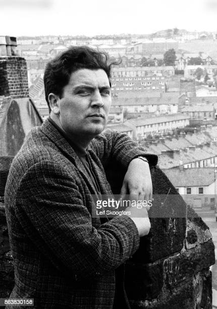Portrait of Irish politician John Hume as he poses on a rooftop that overlooks the Catholic Bogside neighborhood Londonderry Northern Ireland 1970 He...