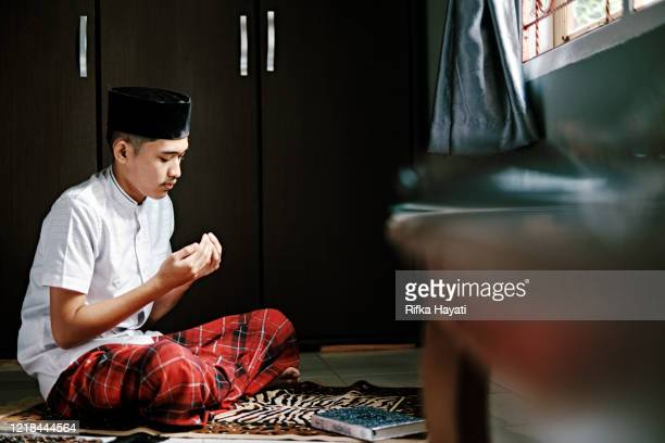 portrait of islam man praying during ramadan - indonesia stock pictures, royalty-free photos & images