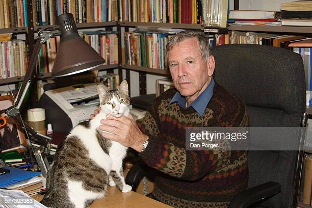 Portrait of Israeli author Amos Oz as he poses with his cat in his study, Arad, Israel, July 19, 2007.