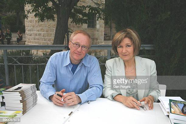 Portrait of Israeli author David Grossman and Portuguese author Lidia Jorge as they sit together at a table to autograph their books during the 2008...