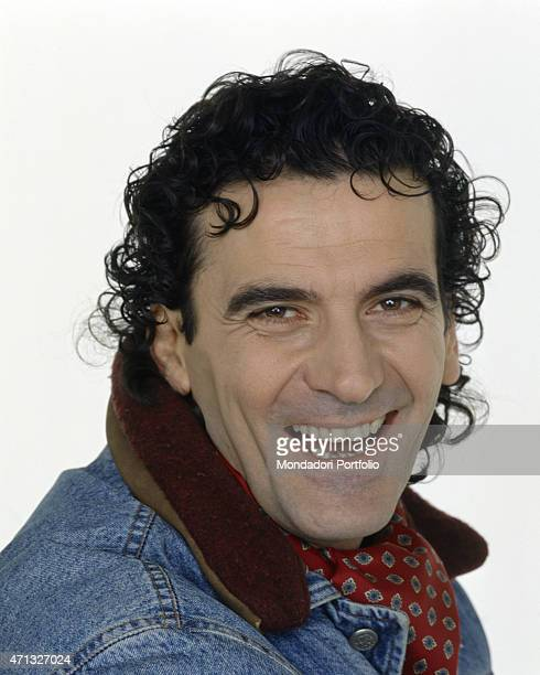 Portrait of Italian actor and director Massimo Troisi smiling 1991
