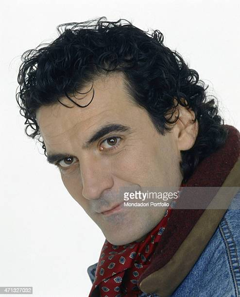 Portrait of Italian actor and director Massimo Troisi wearing a scarf 1991