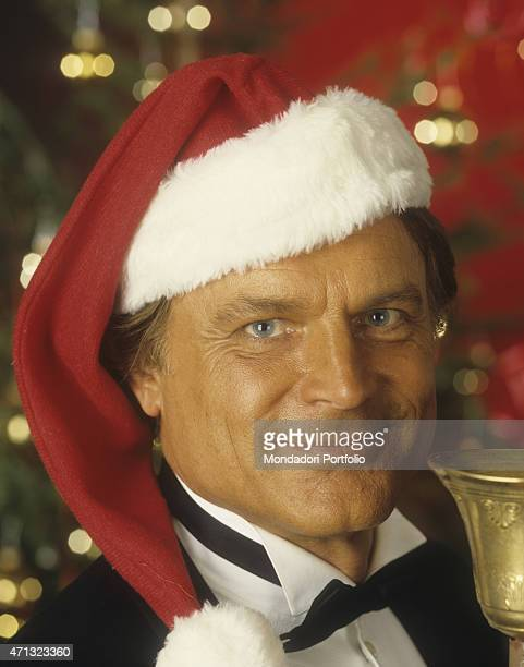 Portrait of Italian actor and director Terence Hill wearing a Santa hat He's one of the main characters of the film Troublemakers 1994