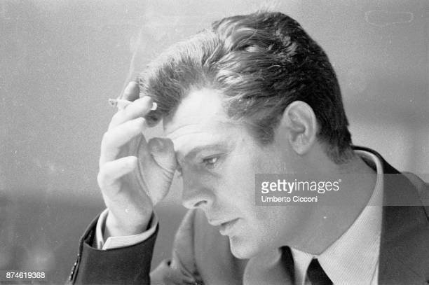 Portrait of Italian actor Marcello Mastroianni while smoking a cigarette Rome 1960