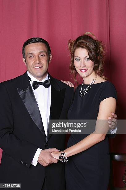 Portrait of Italian actors Flavio Insinna and Milena Miconi hand in hand in a photo shooting on the set of the TV series 'Don Matteo 5' inside the...