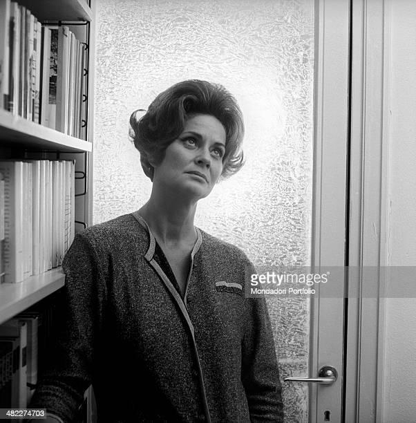 Portrait of Italian actress Alida Valli beside a bookcase Italy 1960s