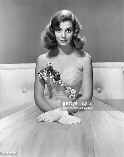 Portrait of Italian actress and model Pier Angeli as she poses in an evening gown and gloves circa 1950
