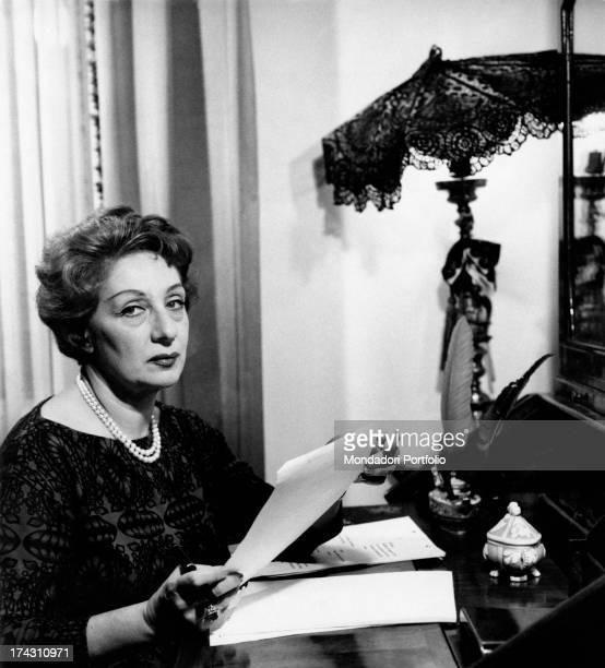 Portrait of Italian actress Andreina Pagnani sitting in a chair in her house Rome 1964