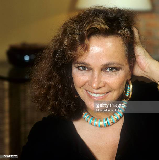 Portrait of Italian actress Laura Antonelli running her hand through her hair 1989