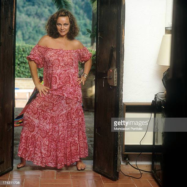 Portrait of Italian actress Laura Antonelli wearing a long pink dress Italy 1989