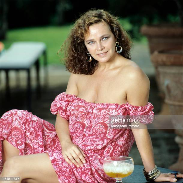 Portrait of Italian actress Laura Antonelli wearing a lownecked pink dress Italy 1989