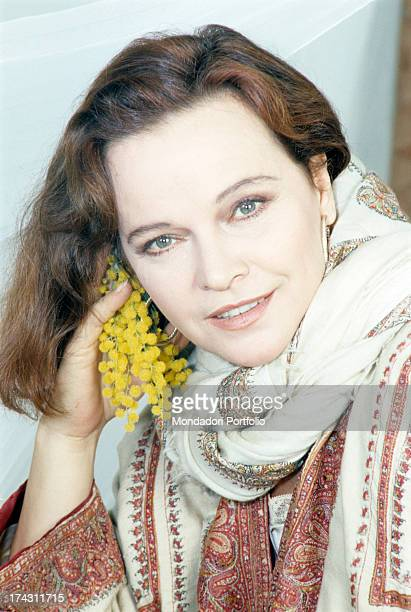Portrait of Italian actress Laura Antonelli with a bunch of mimosa in her hand Italy 1990