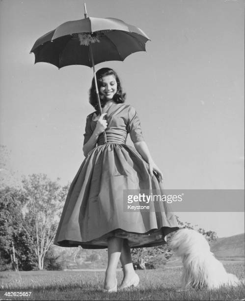 Portrait of Italian actress Pier Angeli holding a parasol circa 19501955