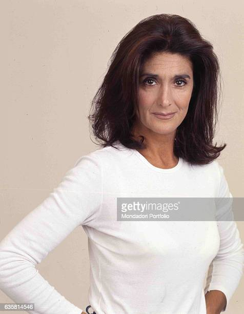 Portrait of Italian comedian Anna Marchesini posing for a studio photo shooting. Italy, 1998