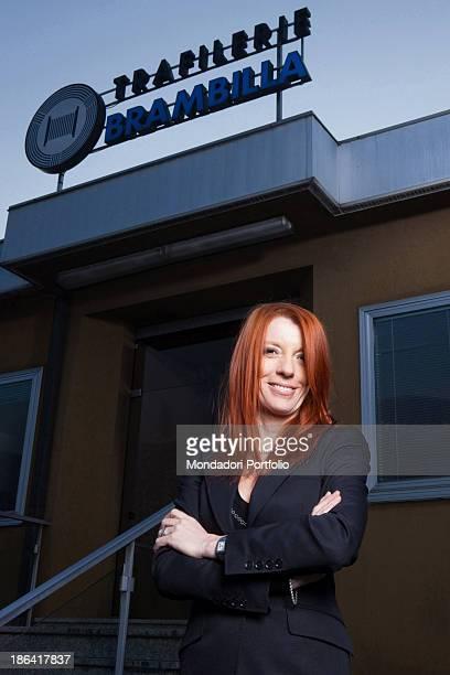 Portrait of Italian entrepreneur and politician Michela Vittoria Brambilla at the entrance of Trafilerie Brambilla Calolziocorte 17th January 2012