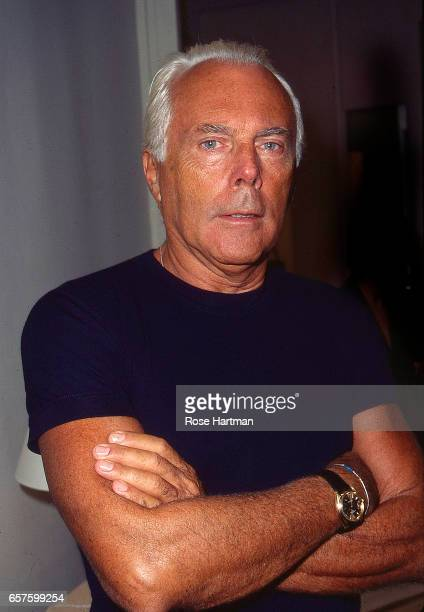 Portrait of Italian fashion designer Giorgio Armani as he poses, arms crossed at the Armani boutique , New York, New York, 1992.