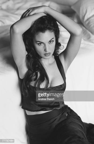 Portrait of Italian film actress and fashion model Monica Bellucci as she holds her arms above her head 1996