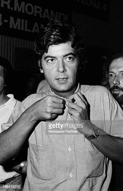 Portrait of Italian politician and vicesecretary of Italian Socialist Party Claudio Martelli straightening his shirt Italy 1980s