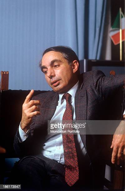 Portrait of italian politician Giuliano Amato Minister of the Treasury in the Goria Cabinet at the desk of his office talking and gesticulating...