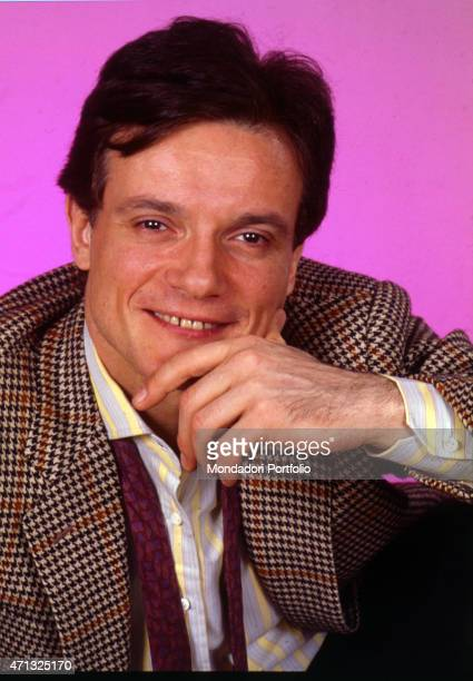Portrait of Italian singer and theatre actor Massimo Ranieri lhand on chin in a photo shooting at the studio Italy 1988