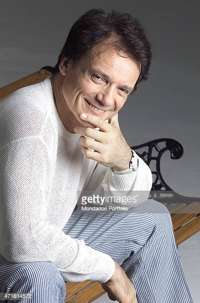 'Portrait of Italian singer and theatre actor Massimo Ranieri sitting on a wooden bench in a photo shooting for his new show 'Siamo tutti invitati '...