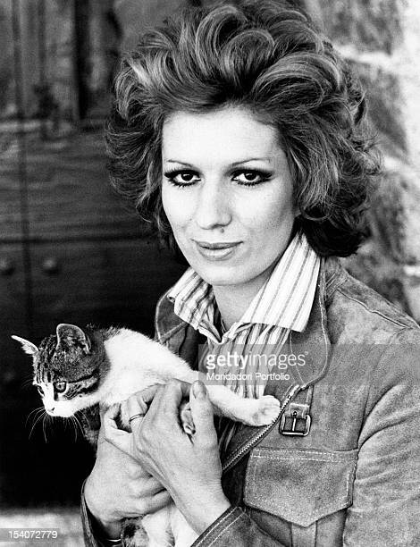 Portrait of Italian singer and TV presenter Iva Zanicchi holding a cat Lesmo 1970s