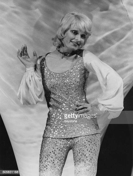 Portrait of Italian singer Rita Pavone wearing a sequin outfit as she performs in a singing contest Paris circa 1965