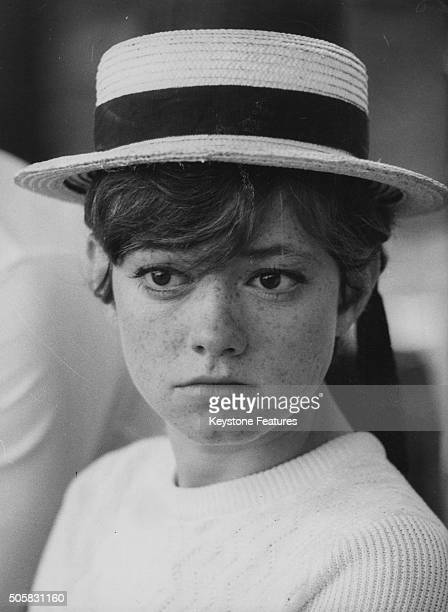 Portrait of Italian singer Rita Pavone wearing a straw boater hat circa 1966