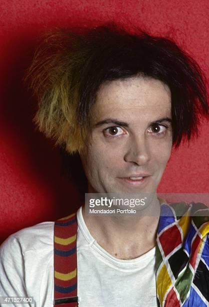 Portrait of Italian singersongwriter guitarist and theatre artist Alberto Camerini dressed as Arlecchino Italy 1981