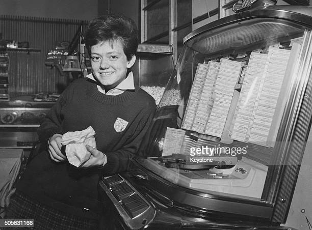 Portrait of Italian teenage singer Rita Pavone standing in front of a jukebox Rome February 1963