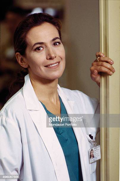 Portrait of Italian television host and actress Barbara D'Urso in white coat posing for a photo shoot on the set of the TV series 'La Dottoressa Giò'...
