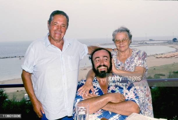 Portrait of Italian tenor Luciano Pavarotti as he poses at his home with his parents Fernando and Adele Pavarotti Pesaro Italy 1993